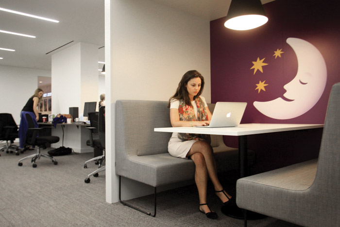 Agile staff use this quiet meeting space/hub within a shared drop-in zone