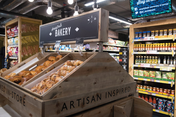 A range of different display options at the latest SimplyFresh at the University of Surrey helps to avoid customers walking through the store on autopilot, while natural materials enhance the sense of old-fashioned values and freshness