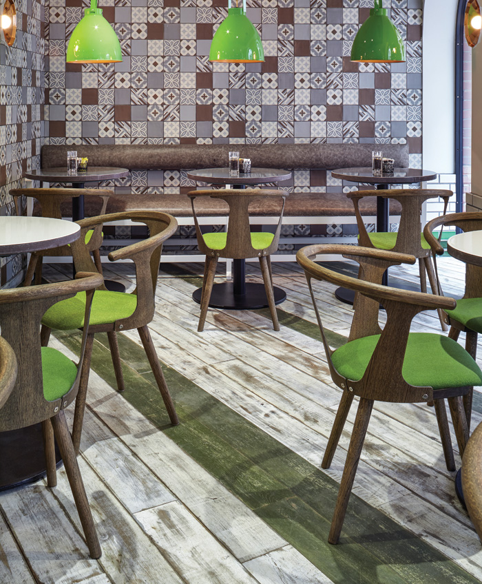 Havwoods' Relik range is made from reclaimed planks and beams, mainly salvaged from demolition sites in Transylvania, then planed and sanded into straight solid or engineered boards. The tough timber can be painted or finished in many ways to provide bespoke solutions, such as this floor at the Z Hotel in Piccadilly.