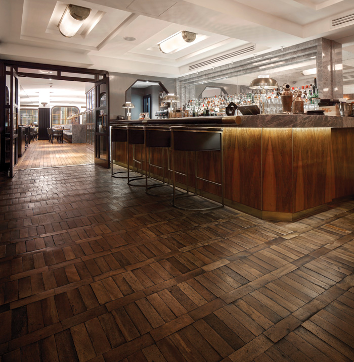 Design company Macaulay Sinclair had the job of turning Manchester's Grade II listed former High Court Registry Office into the Hawksmoor 130-seater restaurant and cocktail bar. The company chose reclaimed European oak parquet from the Reclaimed Flooring Company to give an authentic look.