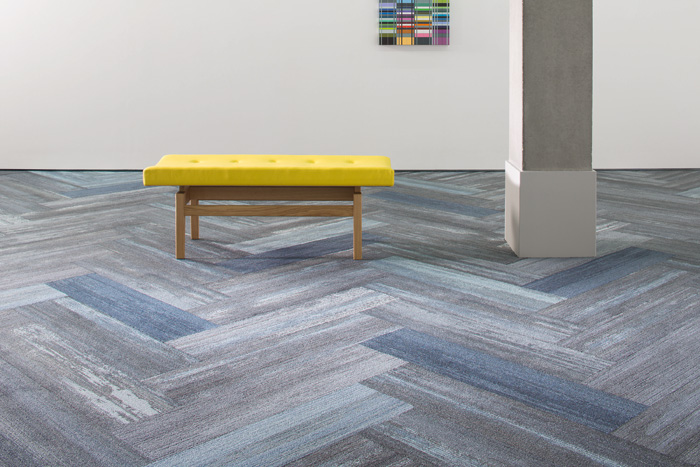 Colour Compositions, Milliken's first collection of carpet tiles in a plank format, opens lots of design possibilities. It is made from Econyl recycled nylon and also has a cushioning backing made from 90 per cent recycled content.