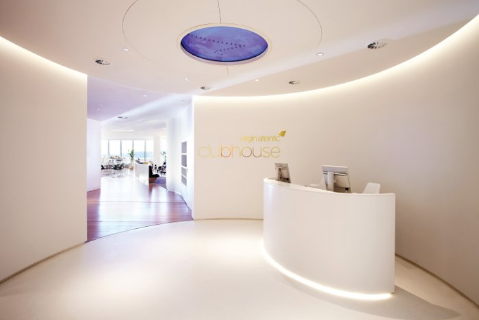 The clubhouse reception has curvaceous walls in Corian and a poured resin floor