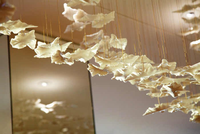 An ceiling installation of 500 leaves in bone china is placed in The Common