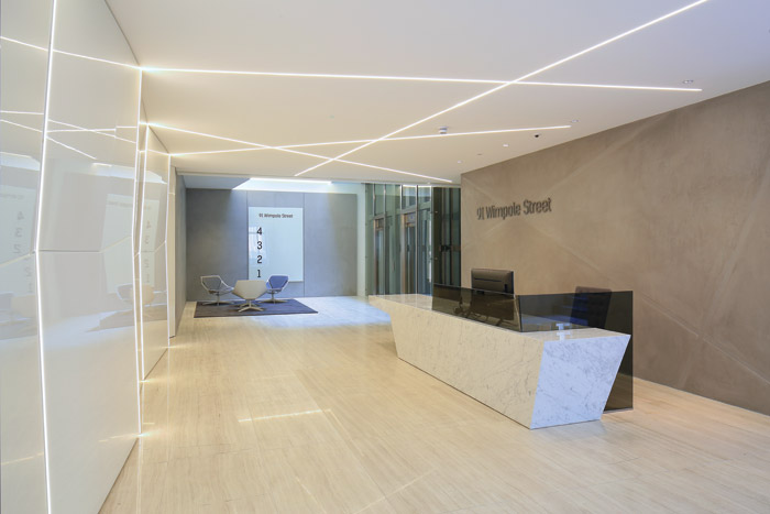 In the minimally styled reception guests are greeted by highly polished reception desk and 'lines of light' cut into the walls and ceiling