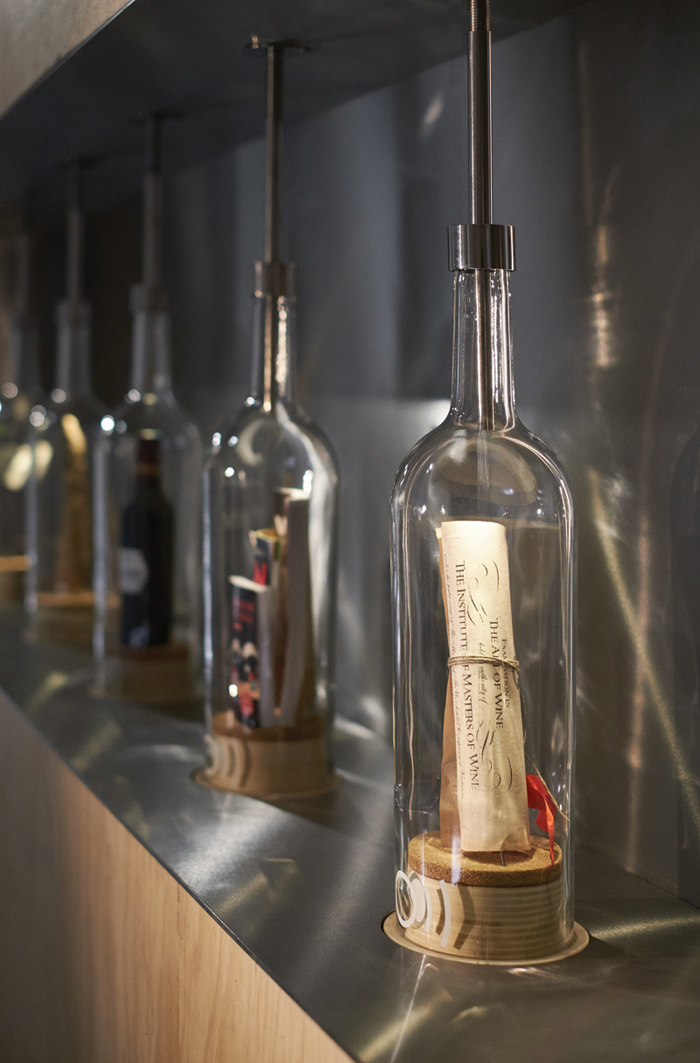 Magnum-size bottles, arranged like a wine production line, look at 21st-century wine stories