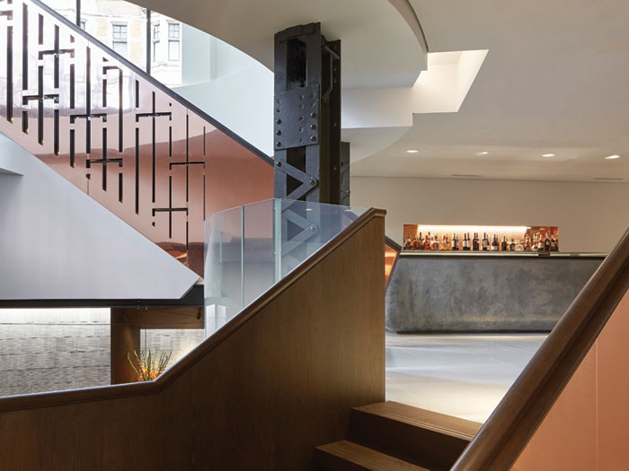 Stairs lead up from the main restaurant area and into the bar space on the mezzanine floor