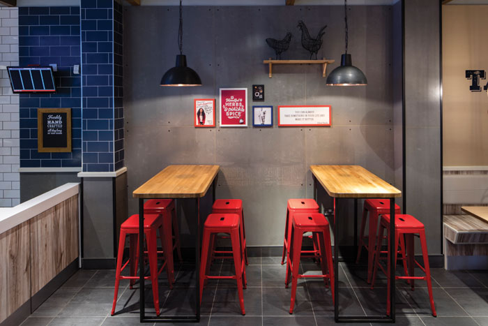 Raw concrete, wood and ceramics are used by I-AM for the new-look KFC