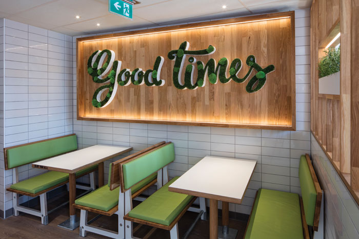 For McDonald's UXUS has taken a hand-crafted approach, offering an array of seating including bleachers and table nooks, plus playful graphics and wall art