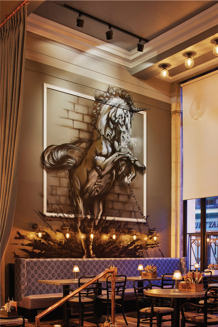 A mural of a chained rearing unicorn – a Scottish heraldic symbol – has been applied to the wall at the entrance to greet visitors to the brewpub