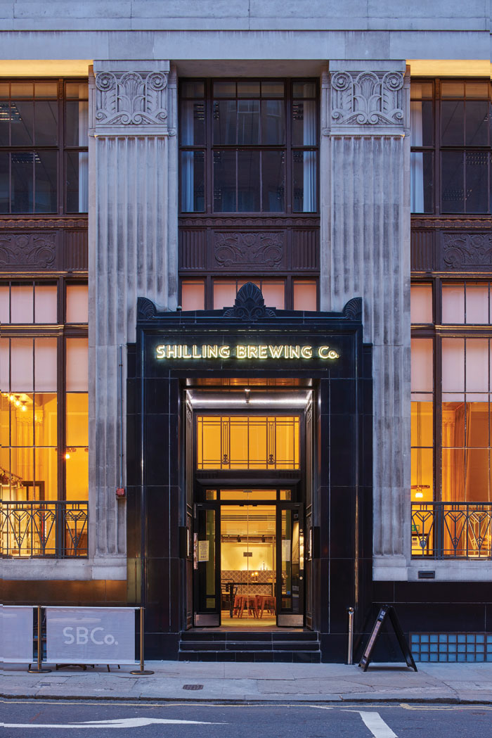 Floor-to-ceiling windows flank the grand entrance to the new brewpub