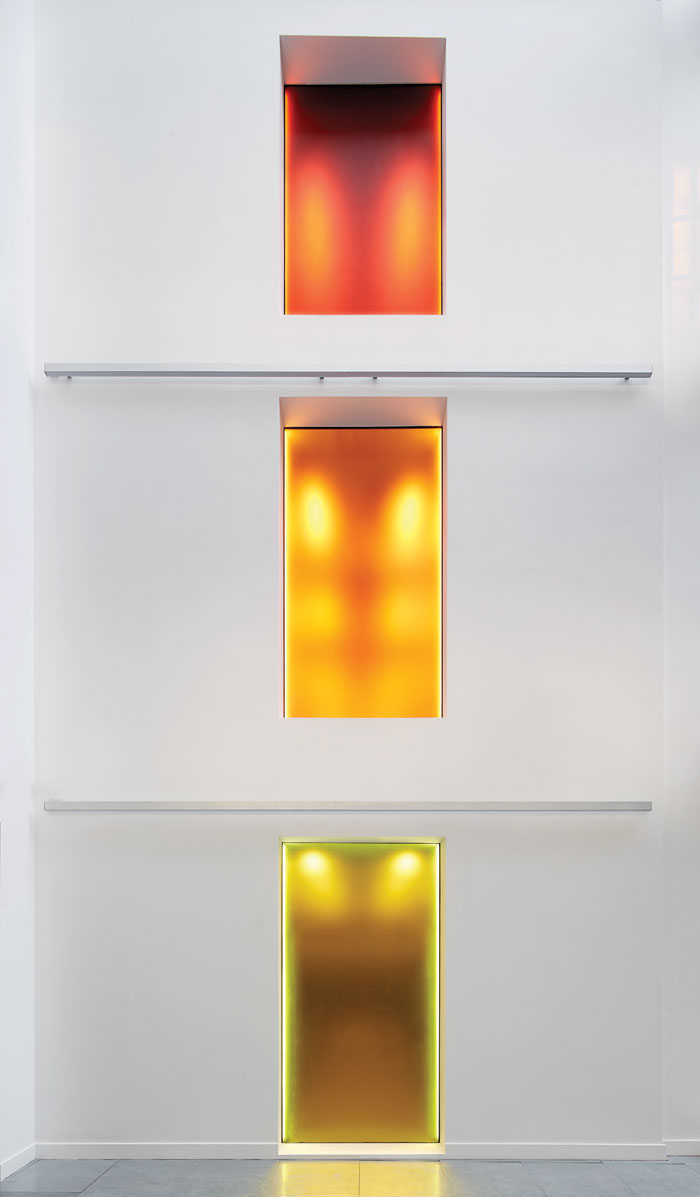 Coloured frosted windows introduce natural light to the toilet space