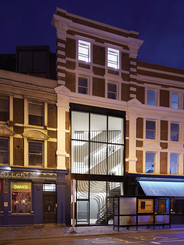 The three-storey-high glass-fronted lobby and sculptural staircase is a standout feature