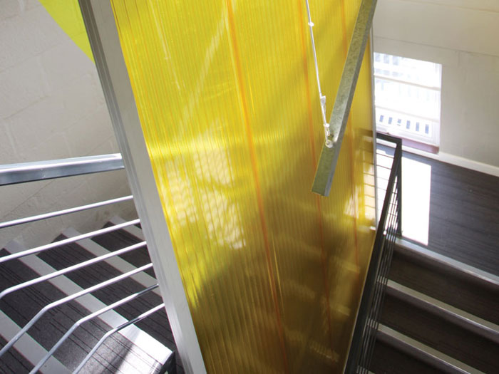 The use of bright colours helps revitalise the former nondescript space