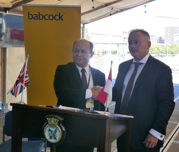 Kaharuddin Djenod, CEO PAL (L) and David Lockwood (R)  Babcock CEO agree AH140 deal on board HMS Argyll