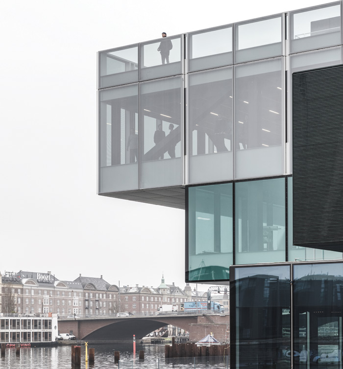 The colours of Blox reflect those of an overcast Copenhagen day, from the sea green of the harbour to the white-grey clouds. Credit: Rasmus Hjortshoj