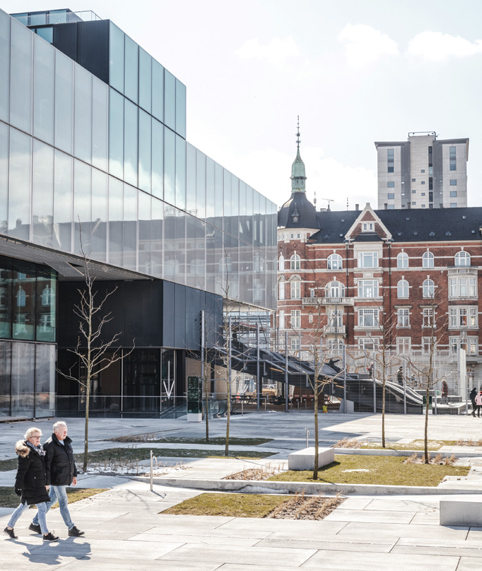 The building's main entrance is accessed from the north-east side, near the city centre, where OMA has created a public square. Credit: Rasmus Hjortshoj