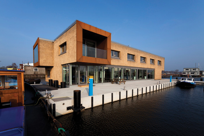 Amsterdam-based Attika Architekten designed a 875 sq m floating office block for the company that cleans the city's canals