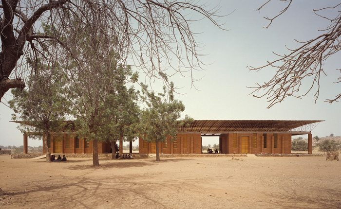 Kéré's first project was a primary school in his home village of Gando. The tin roof of the structure is pulled away from the inner perforated ceiling to aid ventilation