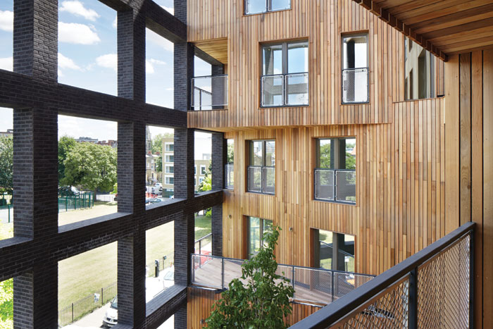Hawkins\Brown's Wenlock Cross building in Hackney, a CLT hybrid building with a timber frame and steel reinforcements where necessary. At 10 storeys tall it provides 50 homes. Photo Credit: Jack Hobhouse