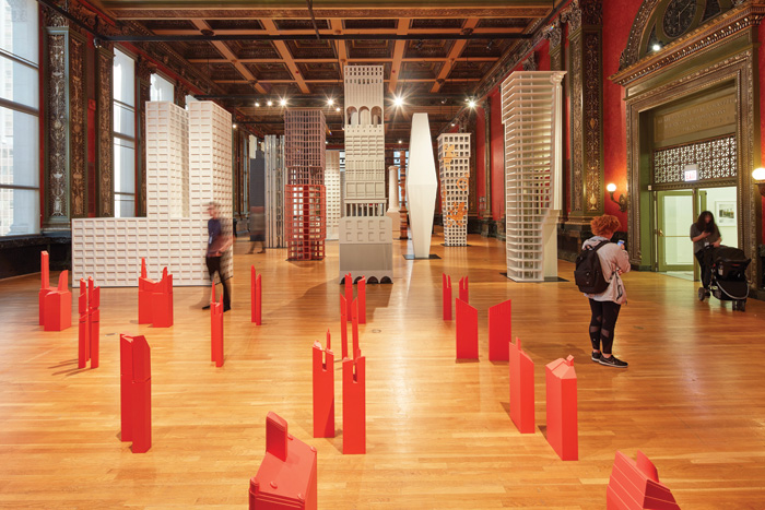 Beyond Charles Waldheim's field of red distorted Chicago towers, contemporary responses to the 1922 Tribune Tower competition are arrayed, here with Sam Jacob Studio's Chicago Pasticcio in centre view