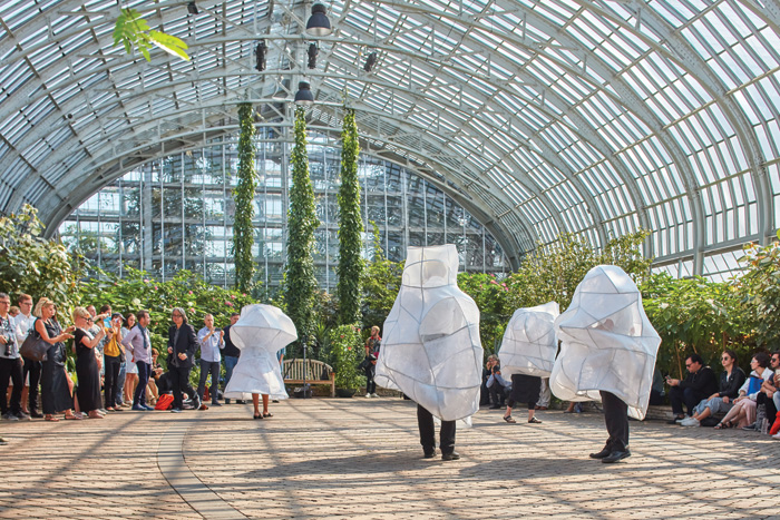 A quartet in costumes by Ana Prvacki and SO-IL perform L'air pour l'air by Veronika Krausas in the Garfield Park Conservatory