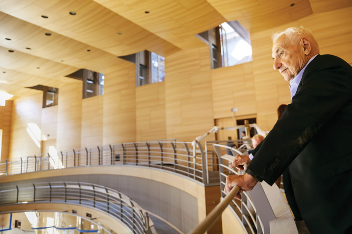 Frank Gehry standing on the undulating balcony overlooking centre stage, has fitted a medium-size concert chamber within a wing of a former depot for stage sets
