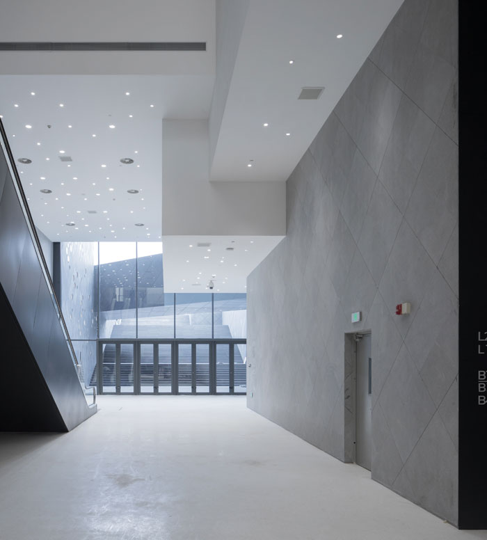 Lighting in some of the internal spaces of the building echoes the appearance of the oculi in the walls. Photo Credit: Iwan Baan