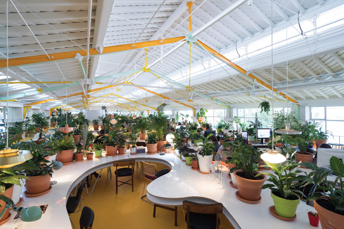 Second Home Lisboa, also designed by SelgasCano, is similarly filled with more than 1,000 plants and trees, and an eclectic mix of mid-century and vintage chairs and lamps