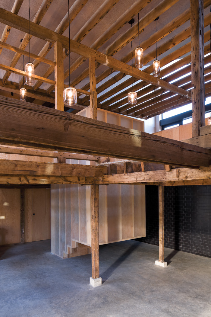 In the granary a lightweight staircase in timber and studwork is encased in fibreglass with lighting strips set into the treads. In its current form the granary could be used by the community for private and public events.  Image Credit: Brotherton Lock