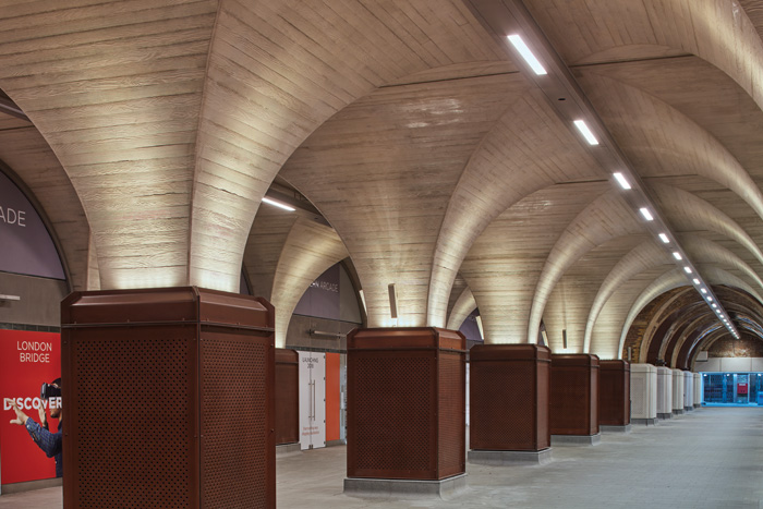 In the new tunnel to connect with the Underground, board-marked concrete pillars replicate the older, brick ones