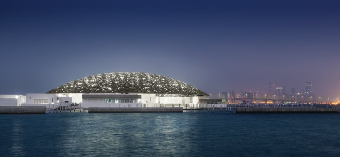 The dome roof of the Louvre Abu Dhabi representing the sky and its constellations looks even more evocative at night