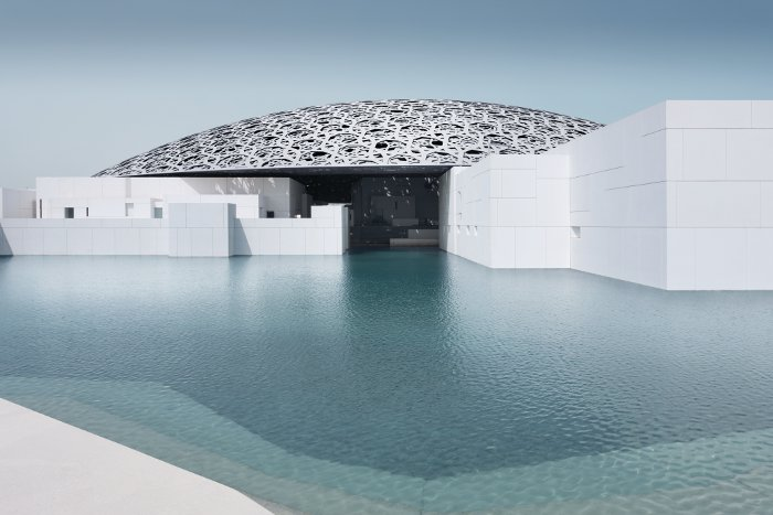 The Louvre Abu Dhabi floats above shallow pools, at sea level, bringing additional reflections, cooling and texture into the complex. Photo Credit: Mohamed Somji