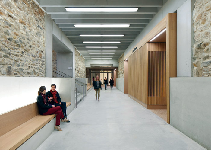A basement was dug down to house a new auditorium, education spaces and workshops. Photo Credit: Hufton + Crow