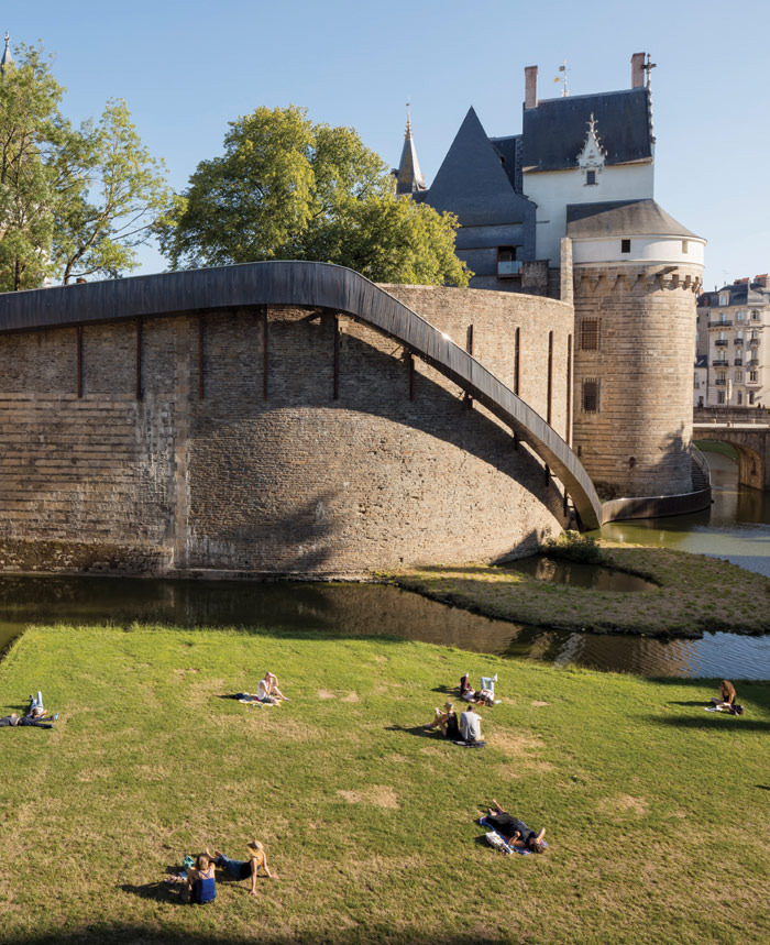 Tact Architectes and artist Tangui Robert have installed a metal slide around the castle for this year's Le Voyage à Nantes. Photo Credit: Philippe Piron/Lvan, Le Voyage A Nantes 2017