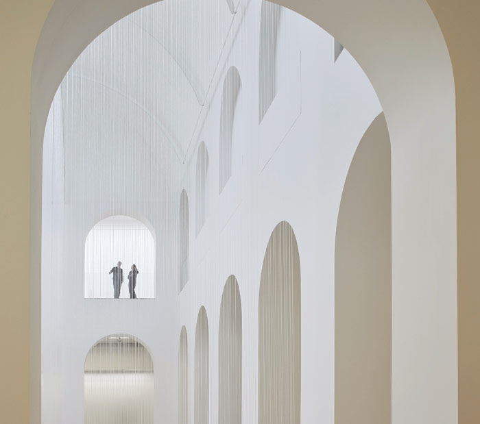 The central Patio of the Palais will host contemporary art installations. For the opening Susanna Fritscher's Nothing but Air, Light and Time fills the space with fine threads. Photo Credit: Hufton + Crow