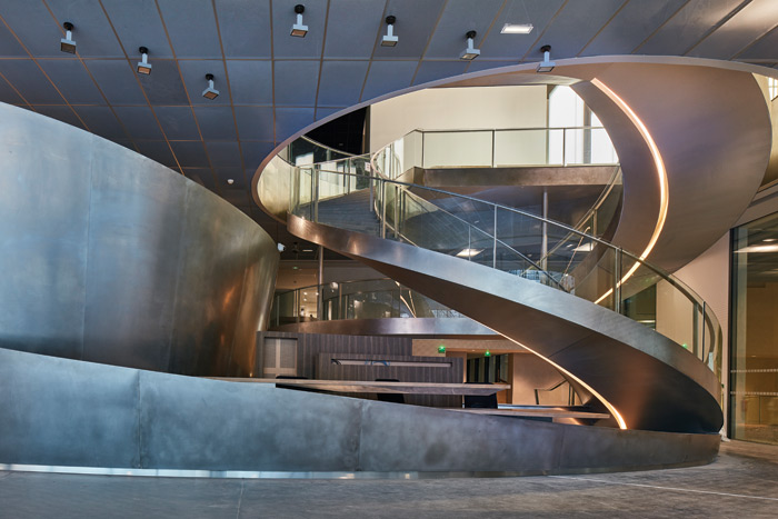 Spiralling stairs lead up from the ground to the exhibition spaces