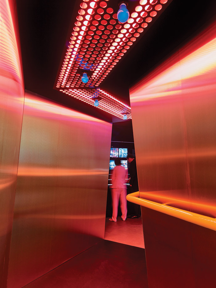 A golden, luminous passageway inspired by Superstudio's Sixties club entrance for Mach 2 in Florence. Image Credit: Mark Niedermann
