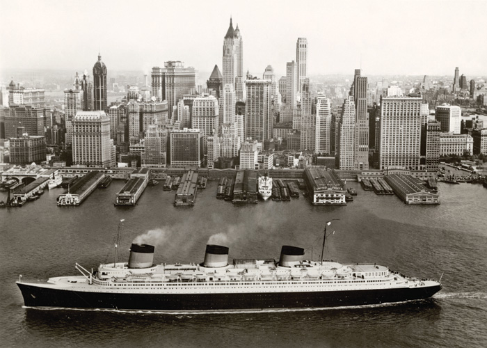 The Normandie sailing alongside New York in 1935. Image Credit: Collection French Lines