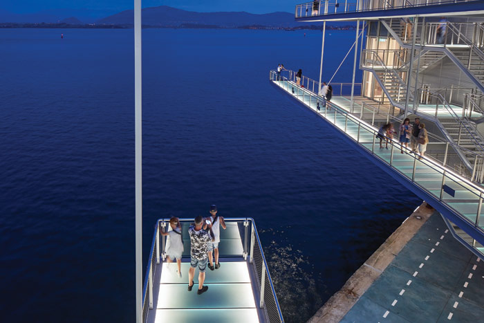 Parallel walkways extend into space to flirt with vertigo