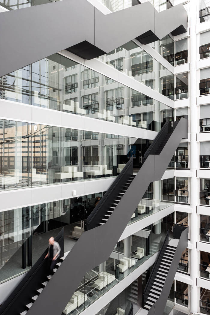 Black single-plate steel 'hanging staircases' connect office floors