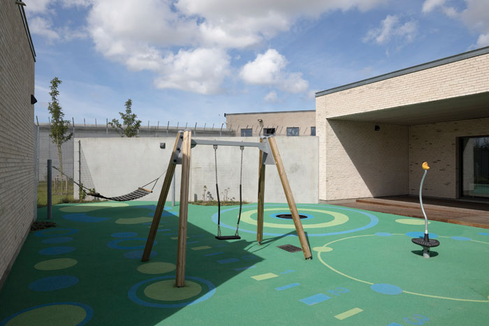 The visitor centre includes meeting rooms and apartments as well as indoor and outdoor play spaces for inmates' children. Photo Credit: Torben Eskerod