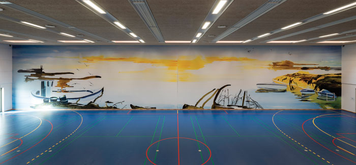 The 660 sq m multi-functional sports hall includes a huge seascape painting from John Kørner. Photo Credit: Torben Eskerod