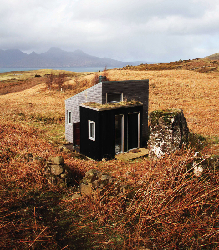 At Sweeney Bothy, its mono-pitched form accommodates a platform bed in the roof and the west-facing elevation is entirely glazed. Photo Credit: Ellis O' Connor