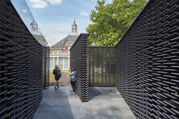 While the structure's outer walls align with the Serpentine Gallery's facade, its internal axis is rotated to match up with the Greenwich Meridian