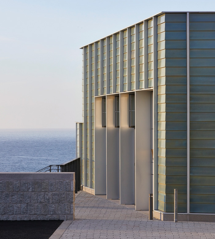 The blue-green ceramic-tiled museum extension by Jamie Fobert Architects for Tate St Ives. Photo Credit: Hufton + Crow