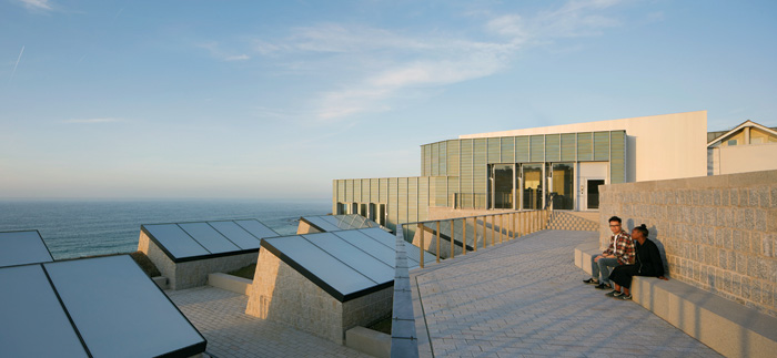 Out of the building a walkway leads to steps and across the roofscape, from where breathtaking sea views can be found. Photo Credit: Hufton + Crow