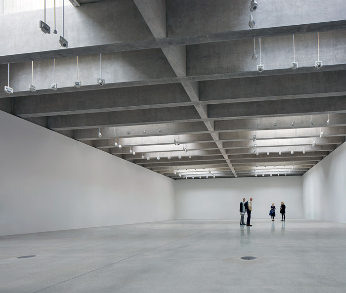 The 5m-high, columnless space can be partitioned into smaller rooms, and the concrete beams are designed to take heavier works hanging from them. Photo Credit: Dennis Gilbert