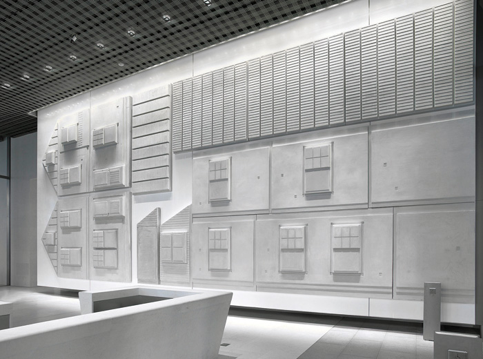 Rachel Whiteread's sculptural work US Embassy (Flat pack house; 2013–15) is installed on the wall of the consular reception