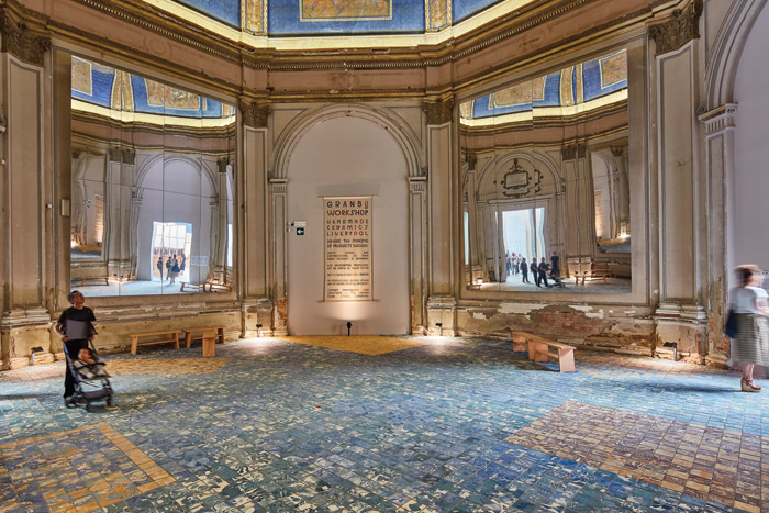 For Factory Floor, Assemble installed 8,000 clay tiles on the floor of the Central Pavilion's neoclassical Chini Room, produced by the practice's Granby Workshop initiative