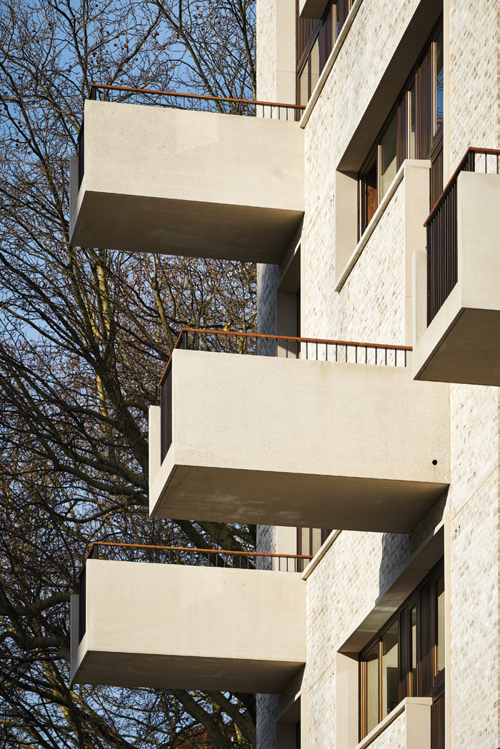 Balconies made of pre-cast concrete project boldly from the southern facade